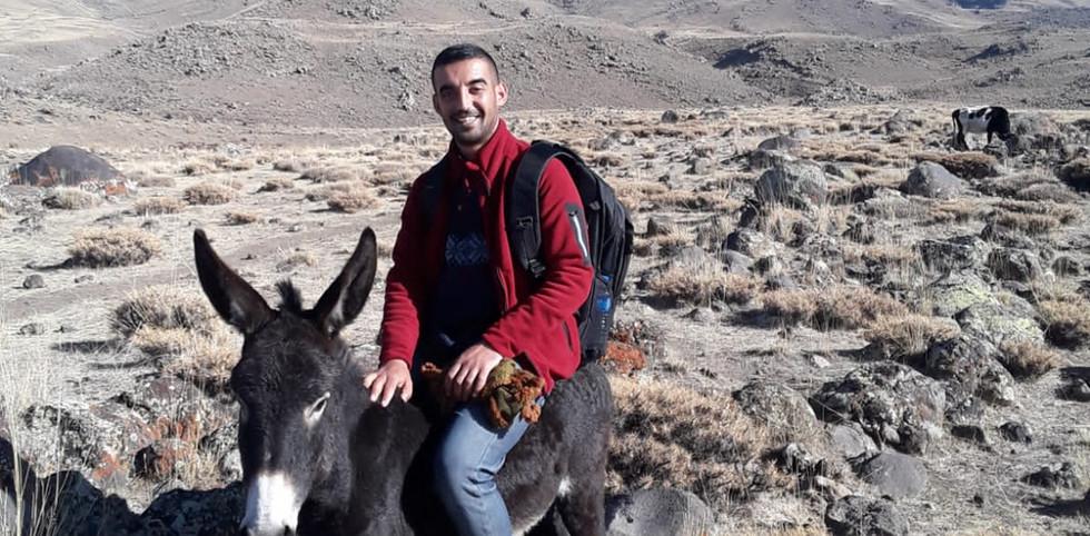 Man Riding A Mule