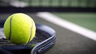 close up of ball and racket on ground.jp