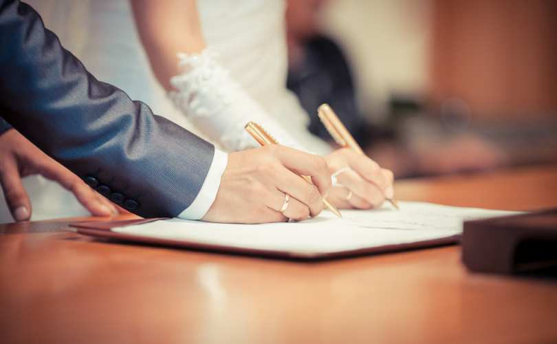 Couple signing a marriage license