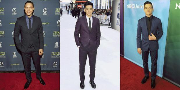 Celebrity men wearing formal suits