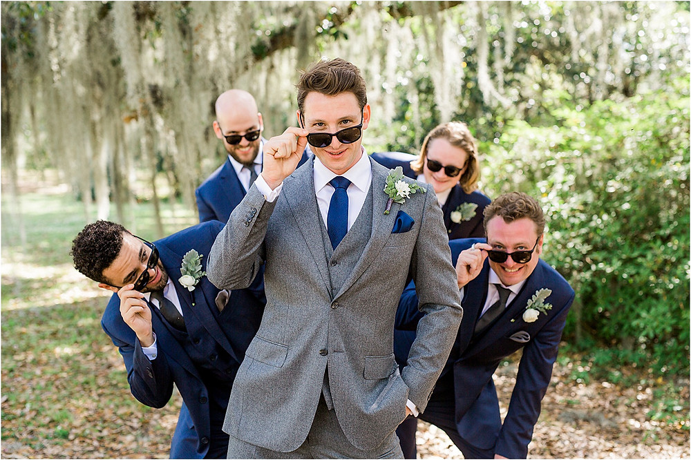 Groom and groomsmen in blue and grey suits