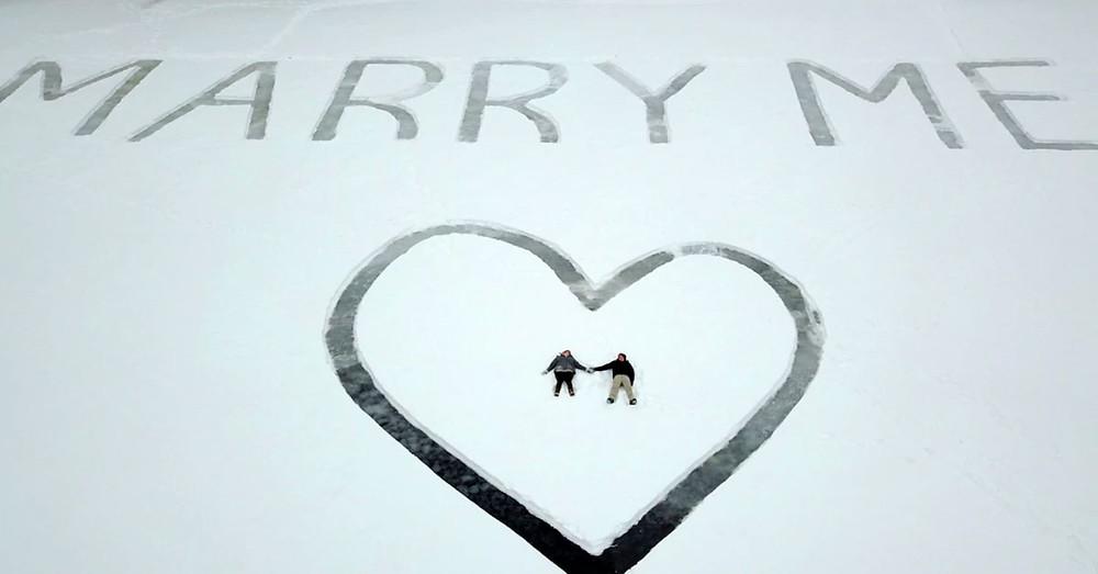 Marriage proposal on frozen lake