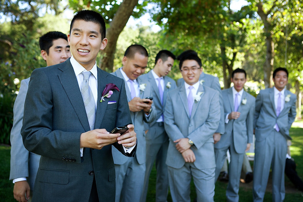 Groom with different colored boutonniere