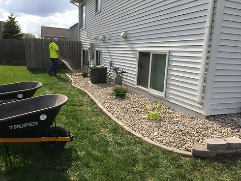 rock installation with edging and plants