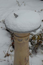 sundial buried in snow
