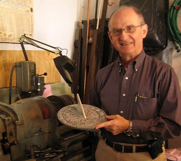 Photo of Chet Roberts holding a sundial.