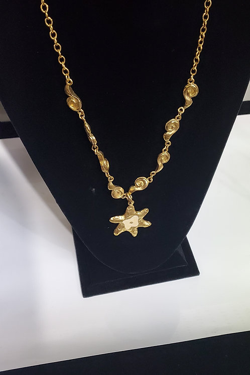 Gold tone necklace with star