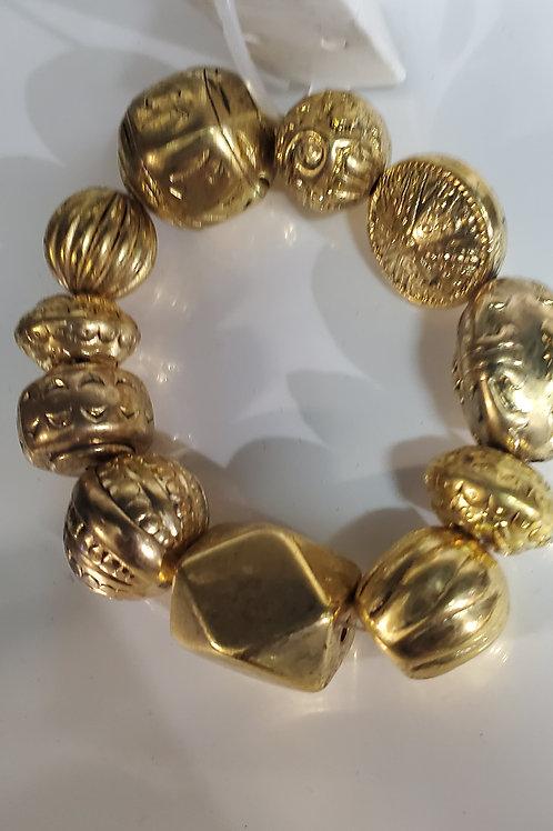 Gold tone exotic bracelet
