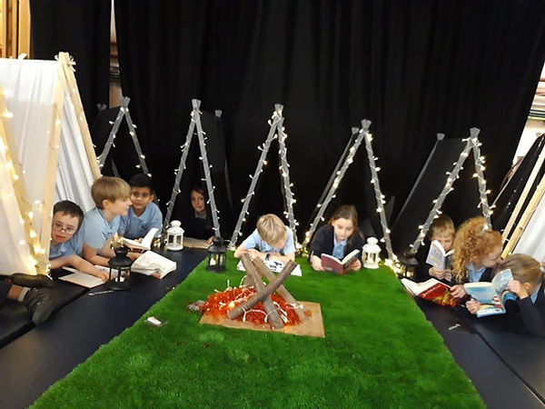 School kids reading area with tents