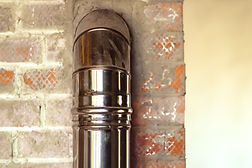 iron pipe of the fireplace of the house