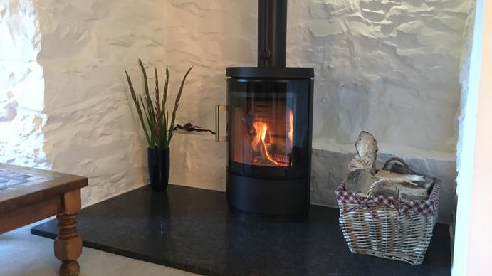 Large white stone inglenook fireplace in