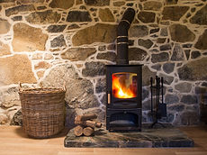 The interior and hearth of a stone walle