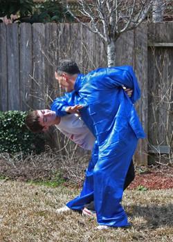 Elbow strike while locking opponent