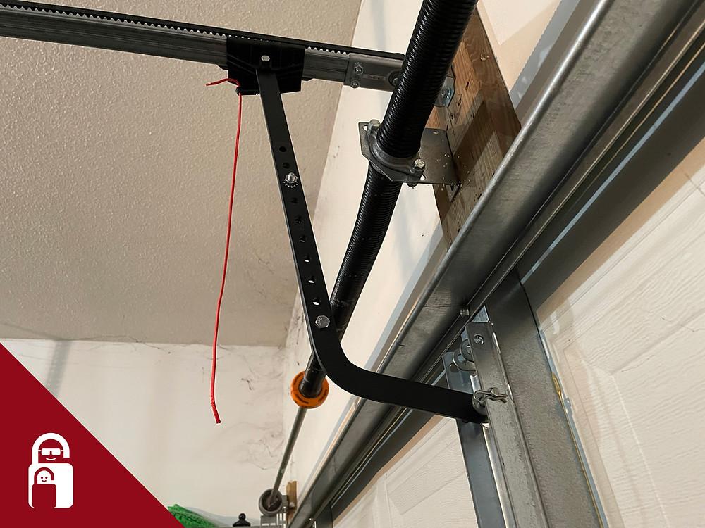 Garage door emergency cord with handle removed.