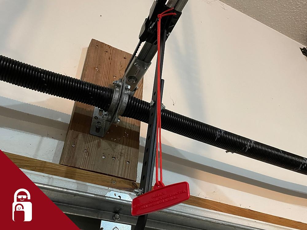 Garage door emergency handle.