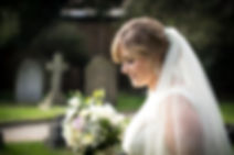 Bride looking down holding her wedding flowers