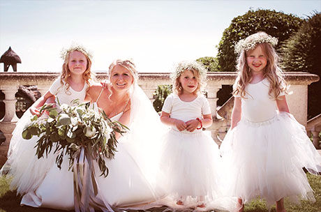 bridesmaids little girls white floral hats bride in garden