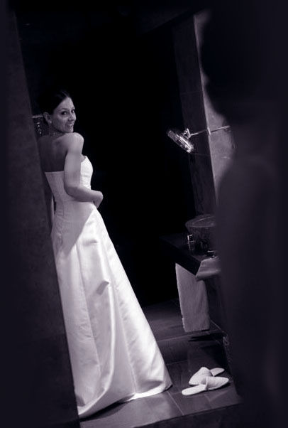 bride looking in mirror wedding dress
