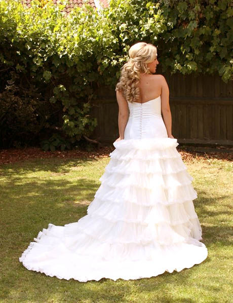 back of blonde bride dress flared fabric