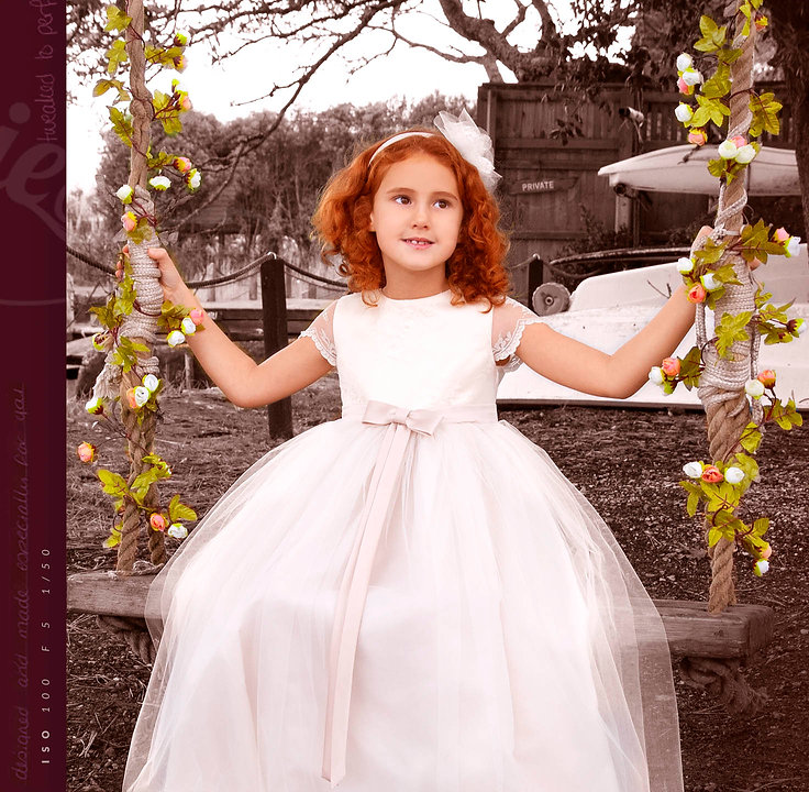 child on swing in bridesmaids dress red hair petite couture