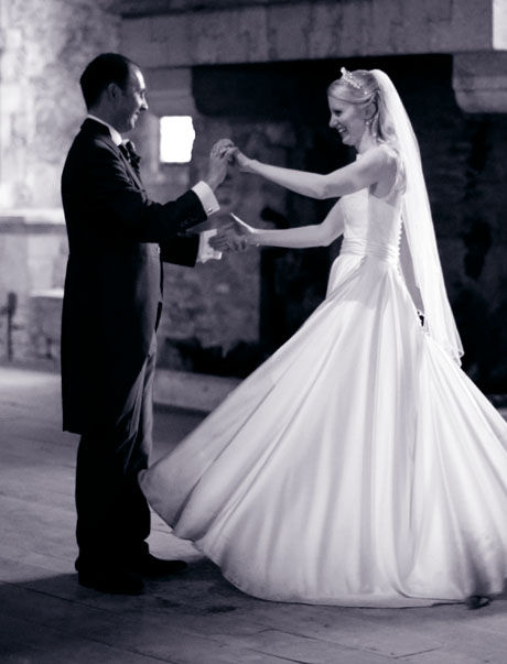 bride and groom dancing black and white amazing bespoke wedding dress