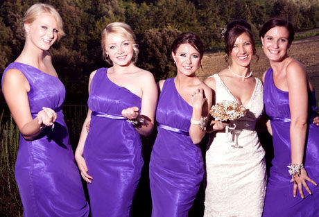 bride and bridesmaids purple designer dresses