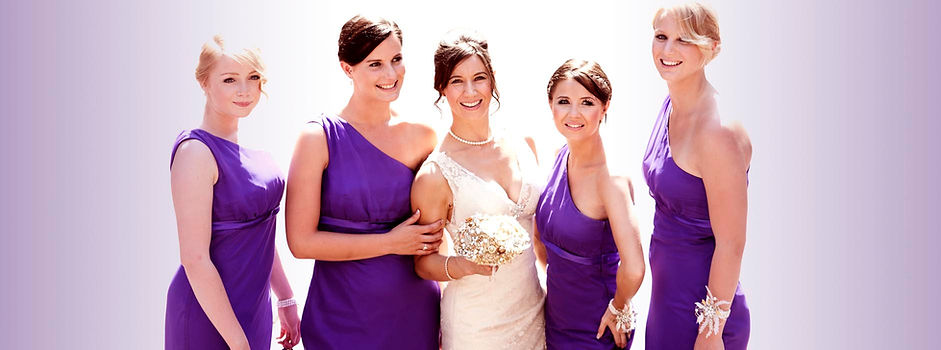 four bridesmaids in beautiful purple dresses and a bride in wedding dress
