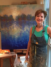 Tina-Mayland-in-front-of-easel.jpeg