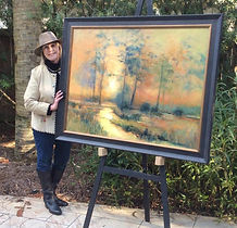 Susan with painting_small.jpg