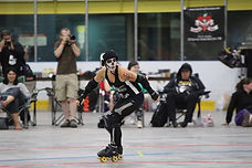 A jammer for the Dead Ringers skates around the trac