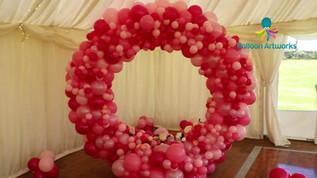 Pink organic balloon wedding arch