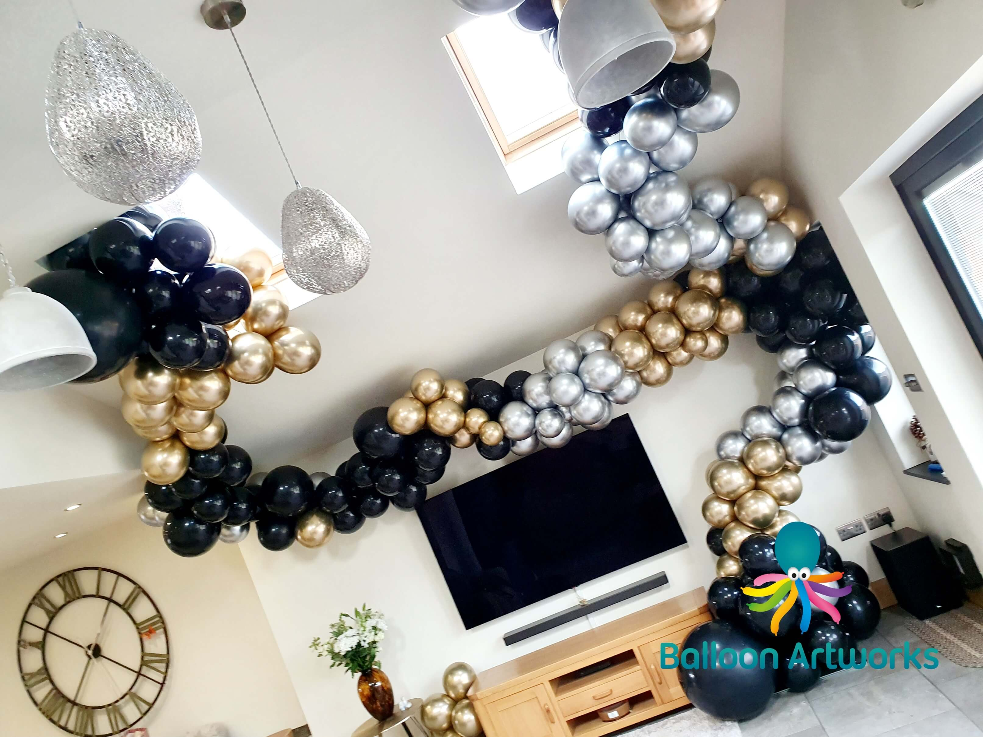 Black and gold organic balloon arch Derb