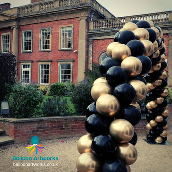 Colwick Hall balloon arch black and gold