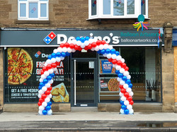 Red, white and blue outdoor balloon arch for a shop opening in Matlock Derbyshire by Balloon Artwork