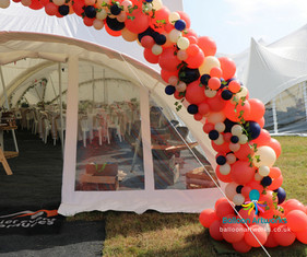 Coral balloon arch with navy and ivory balloons Derby Derbyshire Balloon Artworks.jpg