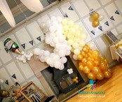 Champagne Bottle Explosion Balloon Arch