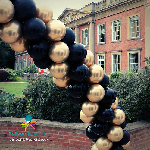 Black and gold spiral balloon arch
