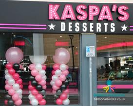 Balloon decoration window display of balloon columns for Kaspas Dessert Bar Derby by Balloon Artworks of Ripley Derbyshire