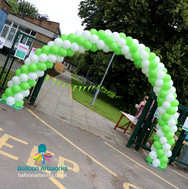 Green and white balloon arch Derbyshire
