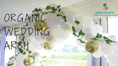 White organic balloon arch with gold accents and greenery by Balloon Artworks of Ripley Derbyshire.