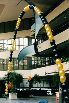 Fabulous black and gold string of pearl balloon arch by aballooncompany.com