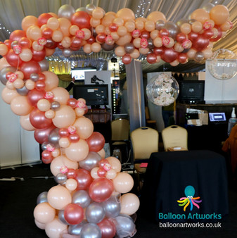 Organic balloon demi arch in rose gold blush and silver balloons Nottingham Balloon Artwor