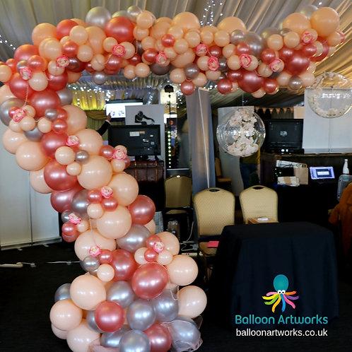 Rose gold organic balloon demi arch