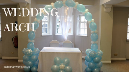 Pretty pale blue and white wedding arch at Makeney Hall by Balloon Artworks of Ripley Derbyshire.