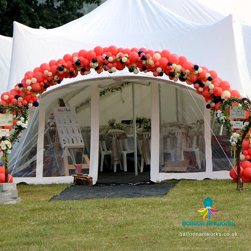 Outdoor organic balloon wedding arch