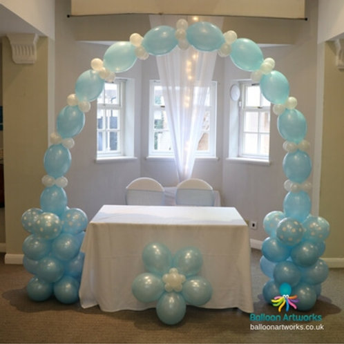 Wedding ceremony table arch