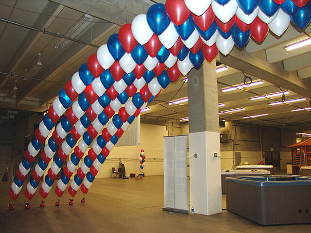 Canopy effect using multiple red, white and blue strings of pearl by balloons-denver.com