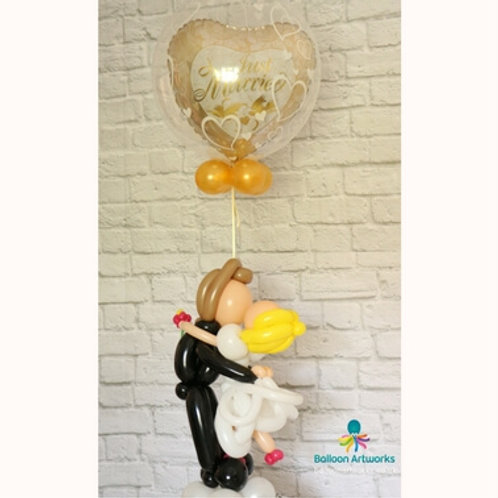 Bride and groom balloon sculpture plus helium balloons