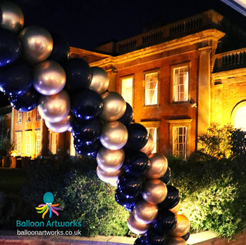 Black and gold balloon arch Colwick Hall