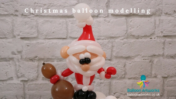 Christmas balloon modelling Santa balloon